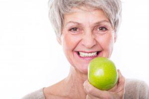 senior woman smiling apple