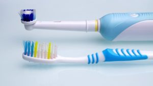 Manual and electric toothbrushes.