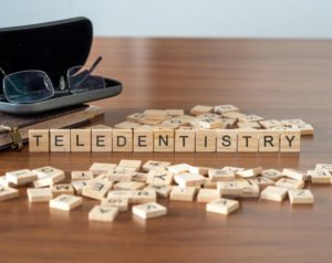 "wooden blocks spelling out ""teledentistry"""