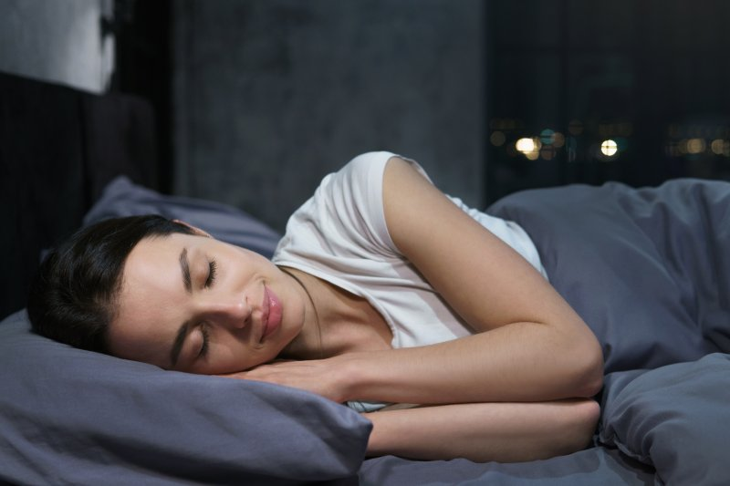 Woman sleeping peacefully in her bed